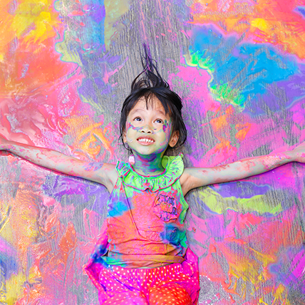 Child covered in paint, colour